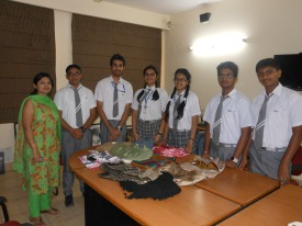 Shivangi and Tanya with their business team and a selection of their bags.