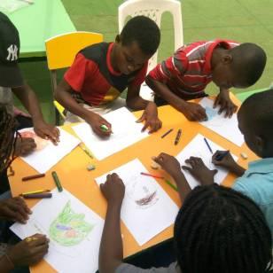 Students at Bellanoor International Community School, Nigeria, designing their school business' logo