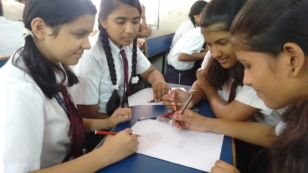 Students at Krishna Public School, India, designing their school business' logo