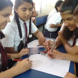 Students at Krishna Public School, India, designing their school business' logo
