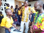 A student presents his sales pitch to a visiting teacher - Liberian Youth Foundation Voc Training Acad (6631)